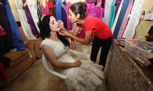 A Syrian refugee has her make-up done as she prepares for her wedding in the Domiz refugee camp in northern Iraq. The Syrian conflict has driven and estimated 2 million refugees abroad and up to 5 million have left their homes. Every day, about 5,000 Syrians cross the borders into Lebanon, Turkey and Iraq.