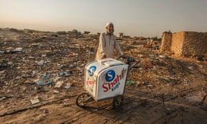 Meanwhiel, an ice cream vendor waits for customers