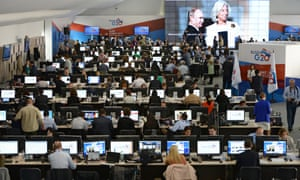 Members of the media work at the International Media Centre during the G20 Summit in St. Petersburg, Russia.
