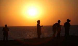 Ultra Orthodox Jews pray as they  perform Tashlich, or the casting off, a Jewish practice performed on the afternoon of Rosh Hashana, the Jewish New Year at a beach in Netanya in Israel