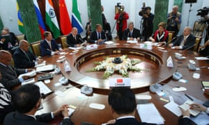 Vladimir Putin (4th L) attends a meeting of BRICS delegations' heads as part of the G20 summit in St Petersburg