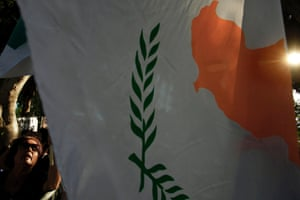 A demonstrator shouts slogans next to a Cyprus national flag, during an anti-bailout protest outside of the parliament in capital Nicosia, Thursday, Sept. 5, 2013.