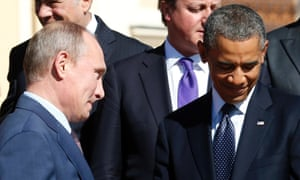 Russian President Vladimir Putin walks past Barack Obama during a group photo at the G20 Summit in St Petersburg.