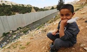 Palestinian refugee on wrong side of wall outside Jerusalem