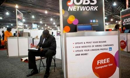 Job-seeker completes an application at a career fair