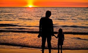 Mother and daughter watch the sun set