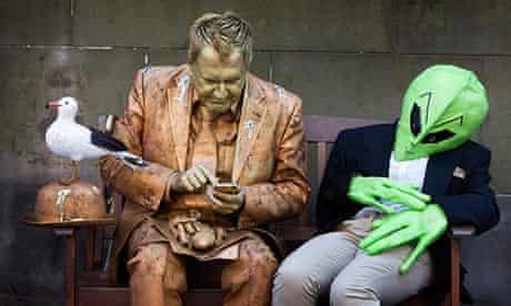 Gold man on phone at the Edinburgh Festival Fringe