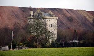 Niddry Castle in West Lothian, backed by Greendyke Bing, a huge spoil heap