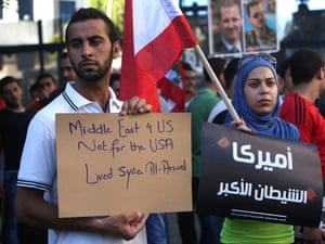 """America the Great Satan"": Lebanese pro-Syrian regime supporters, hold placards as they gather during a demonstration against a possible military action in Syria, near the U.S. Embassy in Awkar, east of Beirut, Lebanon, Friday, Sept. 6, 2013."