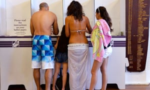A family votes a polling station at Sydney's Bondi Beach on September 7, 2013, in Australia's general election. Latest polls show conservative opposition leader Tony Abbott heading for a landslide victory against Prime Minister Kevin Rudd's ruling Labor Party.