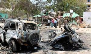 Destroyed vehicles at the scene of the car bombing in Mogadishu, Somalia