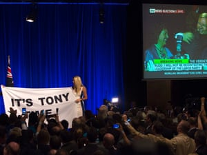 Abbott supporters hold a banner saying 'It's Tony time', as Kevin Rudd gives his concession speech live on TV, at Tony Abbott's election party at the Four Seasons Hotel ballroom in Sydney.  7 September 2013, Photo by Penny Bradfield/Guardian Australia #politicslive