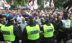 Police hold back the EDL march near Tower Bridge