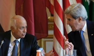 US Secretary of State John Kerry talks to Arab League Secretary General Nabil Elaraby before the start of a meeting with representatives of the League at the US embassy in Paris.