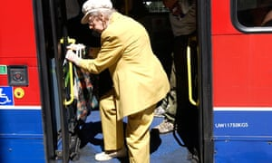 Older woman getting on a bus