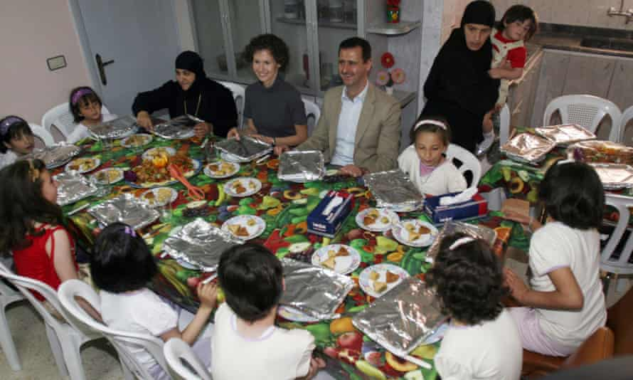 Syrian President Bashar al-Assad, center, with his wife and several Christian orphans at Saint Takla Convent in Maaloula near Damascus, Syria.