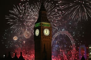 London, England: Fireworks light up the London skyline and Big Ben just after midnight