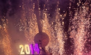 Fireworks explode around the Times Square Ball after it dropped to signal the start of the new year.