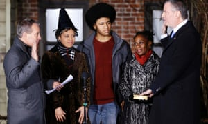 Bill de Blasio, right, watched by his children Chiara and Dante and wife Chirlane McCray, is sworn in as mayor of New York City by state attorney general Eric Schneiderman in the first moments of 2014.