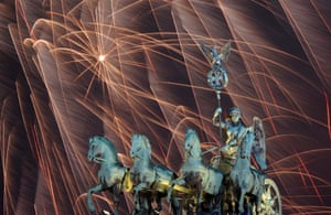 Berlin, Germany: Fireworks illuminate the night sky over the Brandenburger Tor