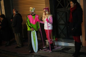 Coin, Spain: Revellers dressed up as Barbie and Ken dolls take part in the New Year's celebrations