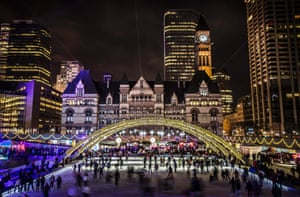 Toronto, Canada: People skate during New Year's Eve celebrations at Nathan Phillips Square