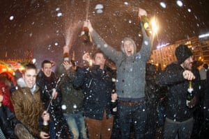 Geneva, Switzerland: People splash champagne shortly after midnight