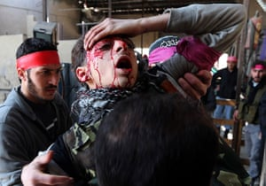 Goran Tomasevic: A Free Syrian Army fighter, who was wounded by a sniper, is carried by othe