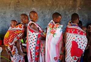 Goran Tomasevic: Masai women wait to cast ballot papers in a polling station during the pres