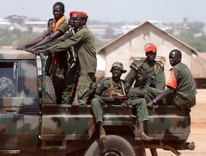 Goran Tomasevic: SPLA soldiers drive in a vehicle in Juba, South Sudan
