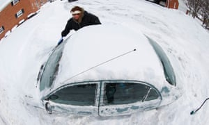Marguerite Johnston uncovers her car in Grosse Pointe, Michigan.The US experienced historic low temperatures this week due to the polar vortex.