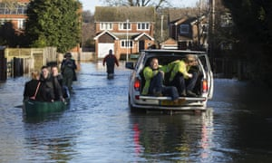 Residents wade through the streets of Purley in Reading. Scientists say David Cameron was right to link recent weather to climate change