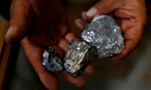 A Bolivian miner shows minerals extracted from Cerro Rico