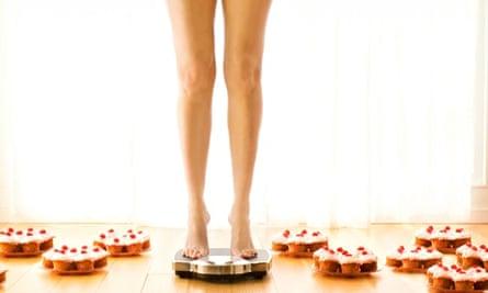 Girl weighing herself