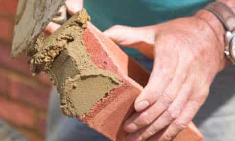 Bricklayer laying a brick