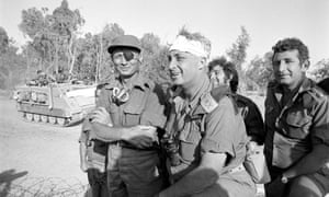 A file picture taken in October 1973 and provided by the Israeli Army shows Ariel Sharon with Moshe Dayan on the western side of the Suez Canal during the Yom Kippor war.