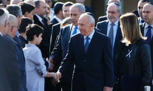 Israel's President Shimon Peres  and Prime Minister Benjamin Netanyahu greet family members of the former Israeli prime minister Ariel Sharon at the start of a memorial ceremony at the Knesset, Israel's parliament, in Jerusalem.