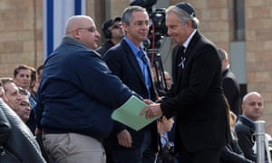 Former British Prime Minister Tony Blair shakes hands with Omri Sharon, the older son of the former Israeli Prime Minister Ariel  Sharon, after greeting Sharon's younger son Gilad on the plaza of the Knesset.