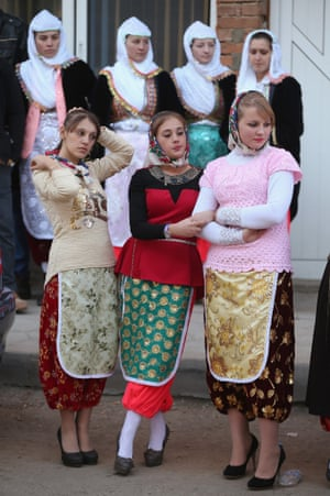 Villagers participate in a group dance on the first day of two-day wedding celebrations.