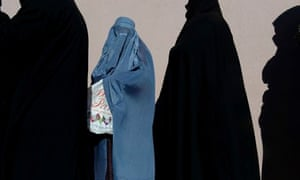 Afghan women line up to receive winter s