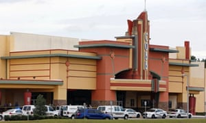 Police vehicles outside the Cobb Grove movie theatre in Wesley Chapel, Florida, after one moviegoer shot another during an argument over text messaging.