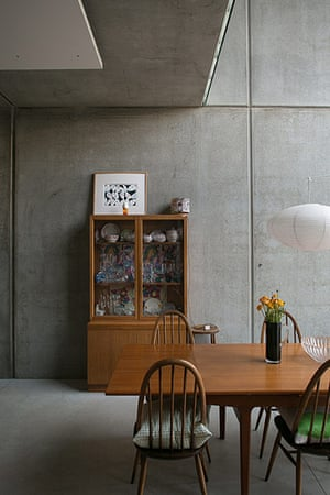 Homes - Concrete house: dining area of house with concrete wall