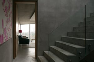 Homes - Concrete house: concrete stairs in hallway looking into room