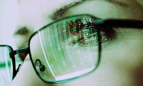 Females Face with Spectacles Reflecting a Computer Screen Display of Stock Market Prices