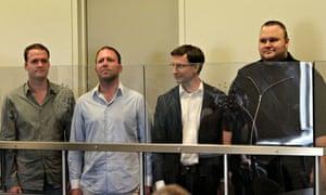 Kim Dotcom (far right) and his fellow defendents following his arrest over Megaupload.com