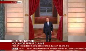 Francois Hollande arrives at his press conference.