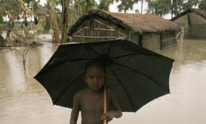 India - Floods - Wading in the rain