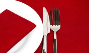 C20879 Kife and fork with white plate on red tablecloth fork knife place plate silverware table setting dinner white red cutlery food clean formal meal lunch fancy china cuisine eat elegant empty utensil restaurant shine flatware porcelain nutrition dining stoneware color tablecloth view napkin image overhead nobody dine Christmas dishes dinnerware brunch breakfast