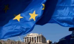 The EU flag flies beneath the Parthenon temple on Acropolis hill in Athens