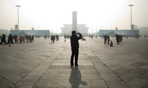 The sights of Tiananmen Square seen through a veil of Beijing smog.
